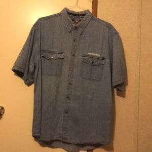 HD denim shirt with pockets and shield on back.